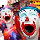 Clowns in a row at Adelaide Royal Show  by Kelvin  Wong