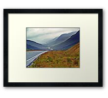 A Winding Road To Stormy Clouds Framed Print