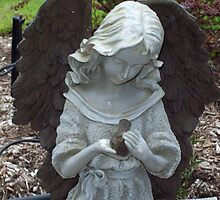 Angel with her pet bird by Marcia Plante