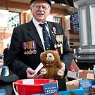Poppy Seller: Victoria Station, London, UK. by DonDavisUK