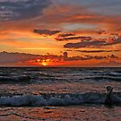 Swimming at sunset by Trine