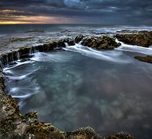 Rockpool and dancing water by Glen Barton