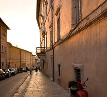 Moped in street at sundown in Assisi by Ian Middleton