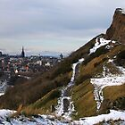 Salisbury Crags and Edinburgh Castle in winter by Linda More