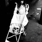 Girl with Skull in her Stroller by UncleBug