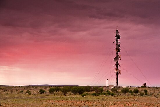 Sunset on Outback Communications. Parachilna, South Australia by Neville Jones