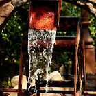Rusty Water Wheel by Angi Allen