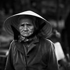 Vietnam - Portrait of elderly woman at markets in Dalat by Chris Bishop