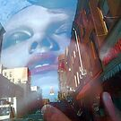 Reflection on Bleecker Street, NYC by RonnieGinnever