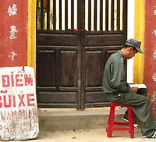 Hoi An - Reader in the street by Maureen Keogh