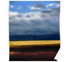 A stormy day over golden wheat Fields Poster