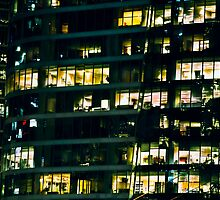 Office builing at night. by Amyn Nasser