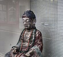 A Sad Buddha Sits In A Window Opposite The Casbah by Jazzdenski