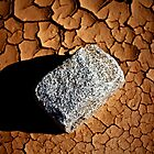 Stone and dry earth by David Pinzer