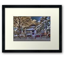 The Decorated Little House in The Snow Framed Print