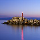 lighthouse in the night by ammit