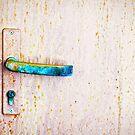 Rusty door handle by Silvia Ganora