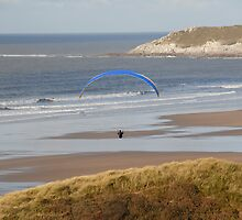 Para gliding over the beach. by sandyprints