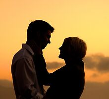 Young Couple Smiling and Hugging at Sunset by Steven Puente