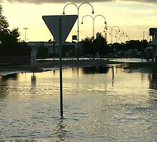 Sunsetting over flooded streets in the CBD. by Chris Chalk