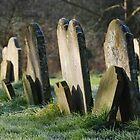 Gravestones in All Saints' Churchyard by Christopher Cullen