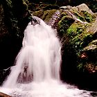 A sparkling waterfall by steppeland
