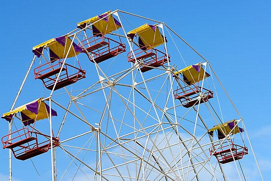 Bright Colourful Ferris Wheel by sallydexter