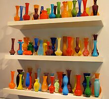 Colourful glass vases on display by Ian Ker