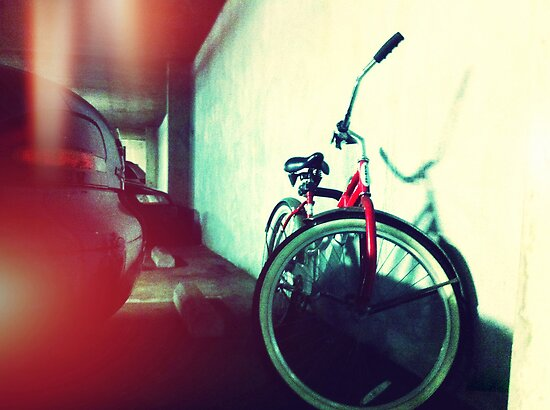 Bicycle In Parking Garage by Justin Karfs