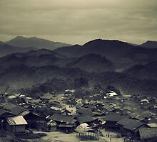 Laos hill tribe village by Christophe Besson