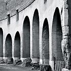 Arches at the Colosseum  by philrwesty