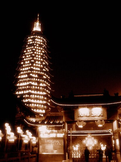 Changzhou Buddhist tower at night, China by Chris Millar