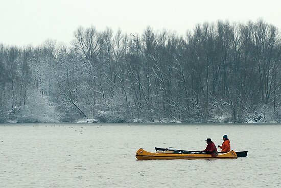 Two canoes on a winter lake by steppeland
