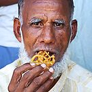 Mr Muslim Enjoys A Jalebi by AlliD