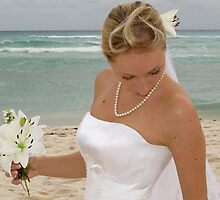 A bride at the beach by Isabelle Larose
