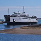 Incoming Ferry by the lighthouse by Russell L. Frayre / Photographer