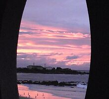 oval window view of sunset tonight at Burnie Beach by gaylene