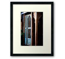 Swinging Saloon Doors Framed Print