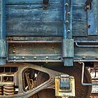 Blue Car Axle (Perris, California) by Brendon Perkins