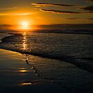 Setting Sun, Bamburgh, Northumberland Coast. UK by David Lewins