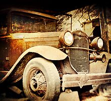 Vintage Ride parked in a barn in rural Pennsylvania  by jenndiguglielmo