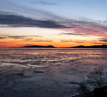 Winter Sunset over Pic Island on Lake Superior at Marathon Ontario Canada by loralea