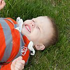 Playing in the Grass- Kansas by Jennifer  Arganbright