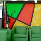 Green chairs with red and yellow  by richard  webb
