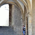 Piper under the arches in Santiago de Compostela by Steve