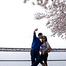 Couple Beside during the Cherry Blossom Festival by KateCraig
