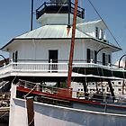 Boat and Lighthouse - St. Michaels, MD by searchlight
