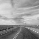 winding desert road by kurtgregory910