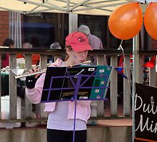 Flautist at the Queens Day celebration. by MrJoop