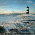 Sunset at Penmon Lighthouse, on the Isle of Anglesey by Beverly Cash